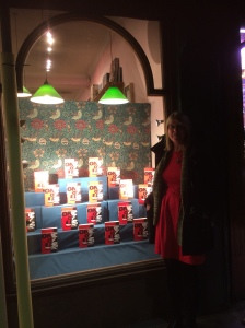 Book sjhop window full of copies of One of us